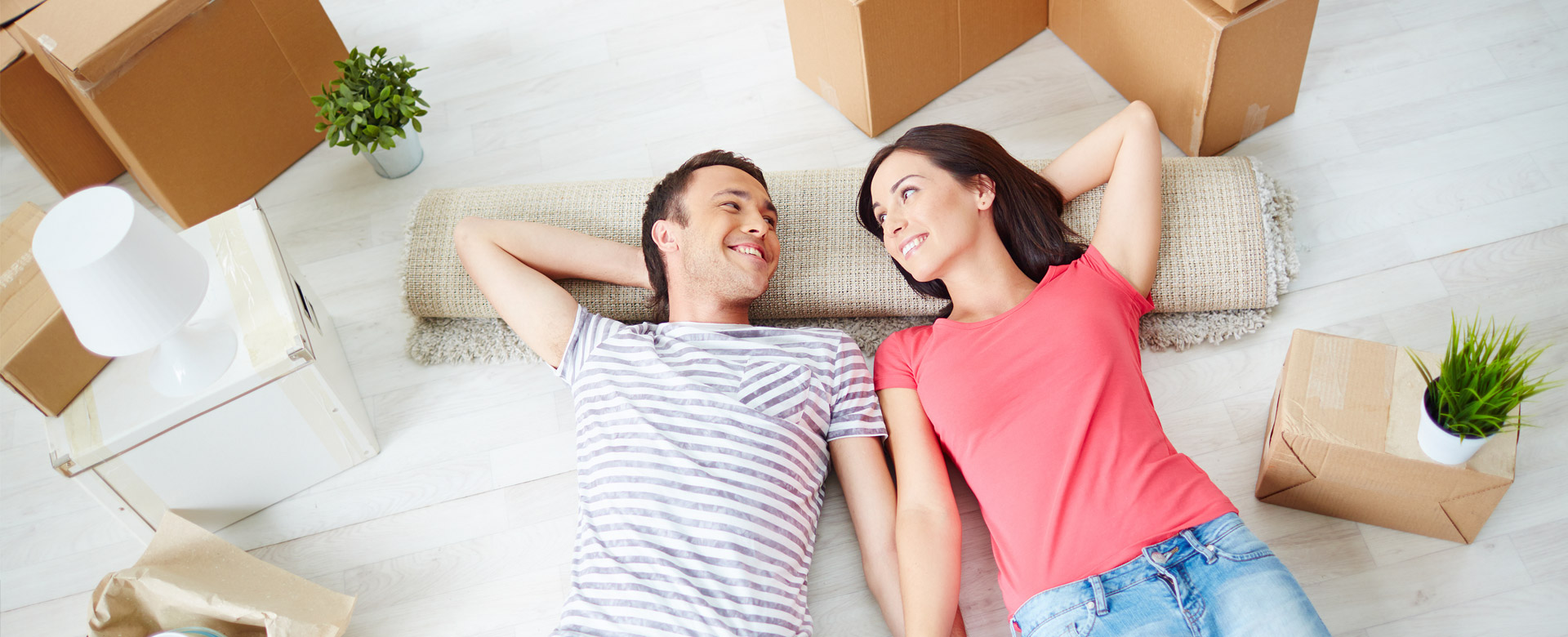 Professional couple moving in to Realstar's apartment rentals