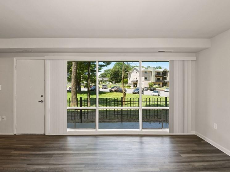 Large ground floor windows and door leading to patio
