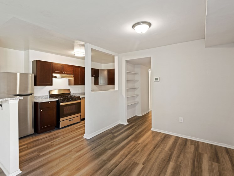 Kitchen with attached breakfast bar and dining area