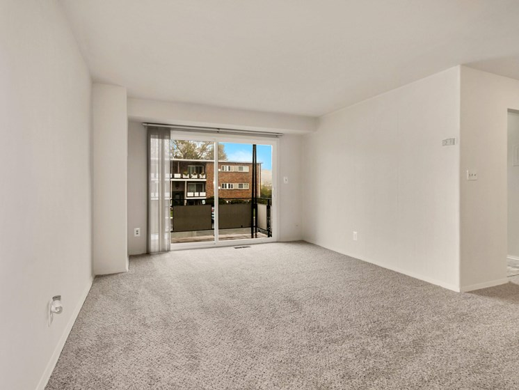 Empty, carpeted living room