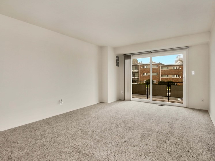 Empty living area with exit to patio
