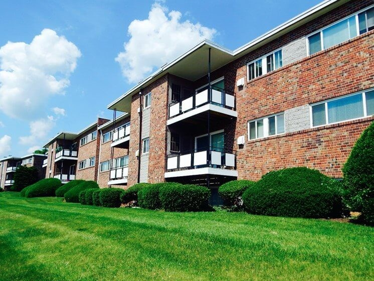Green grass and apartment balconies
