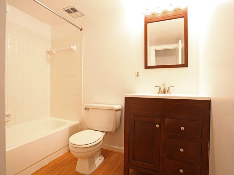 Bathroom with brown, wood vanity