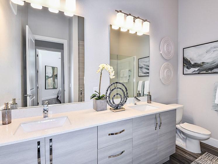 Bathroom With Vanity Lights at Axio at Carillon, Saint Petersburg, Florida