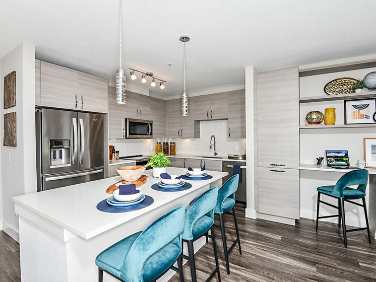 Fitted Kitchen With Island Dining at Axio at Carillon, Saint Petersburg, FL, 33716