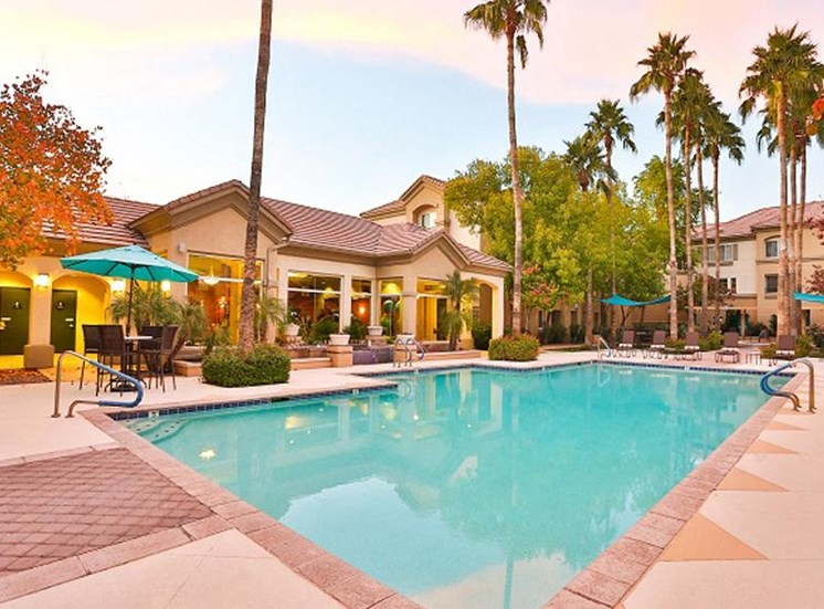 Outdoor pool with lounge seating