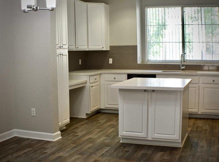 Vacant apartment home kitchen and island