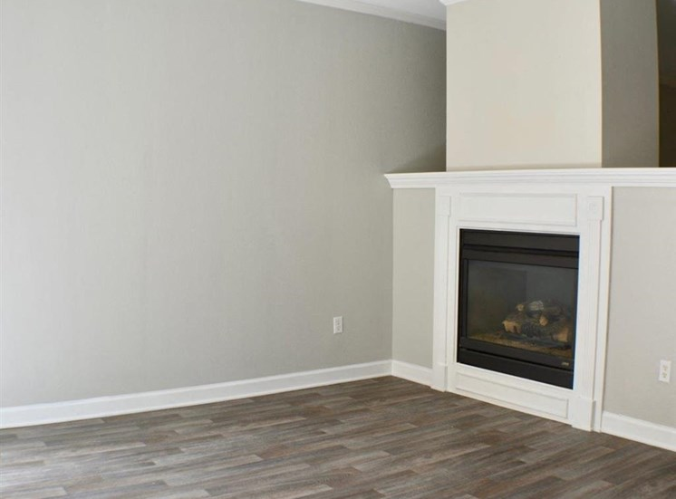 Vacant apartment home corner of living room with fireplace