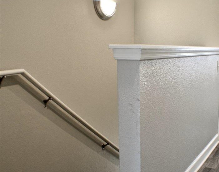 Vacant apartment home stair case leading to first floor