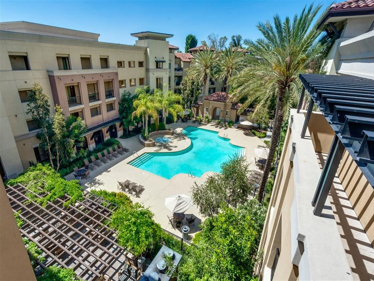 Poolside Sundeck and Grilling Area at The Madison at Town Center, Valencia