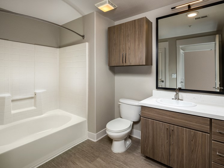 Large Soaking Tub In Primary Bathroom with A Tile Surround at The Madison at Town Center, California