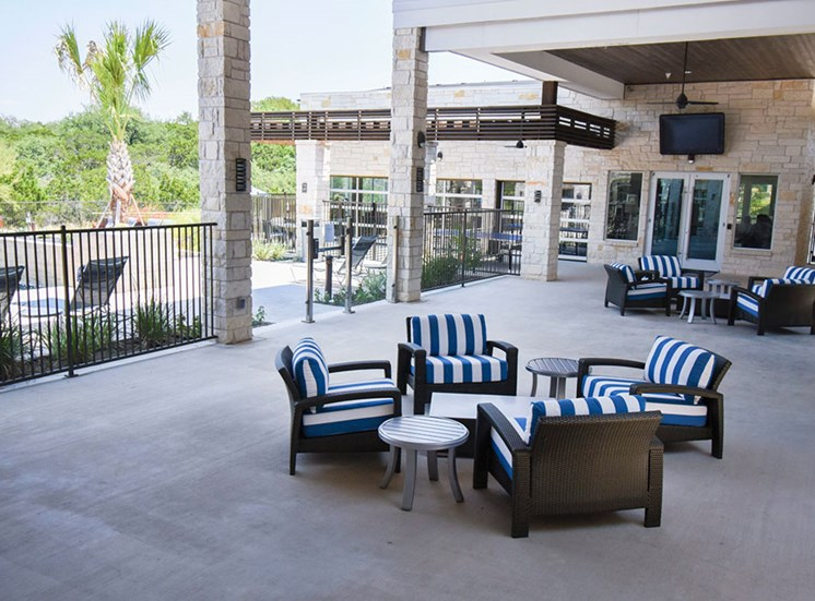 Spacious outdoor community lounge area with TV