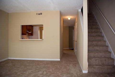 Living room with hallway at Laurel Grove Apartment Homes, Orange Park, 32073