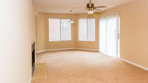 Living room with ceiling fan at Laurel Grove Apartment Homes, Orange Park, FL, 32073