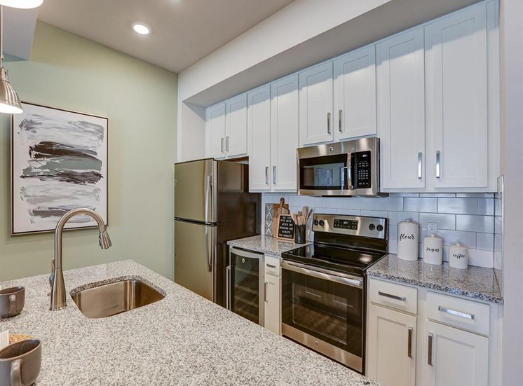Kitchen in one bedroom model apartment at Inspira, Naples