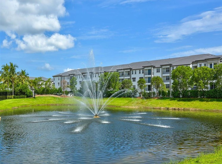 Building at the lake with a fountain at Inspira, Naples, FL, 34113