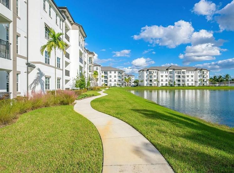 walking path next to building and lake at Inspira, Florida, 34113