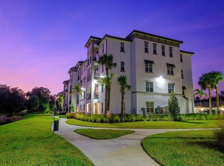 Building at twilight at Inspira, Naples, FL, 34113