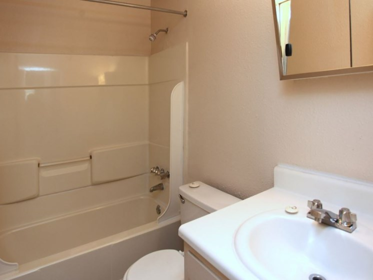 Bathroom with tub/shower combo, sink, and toilet