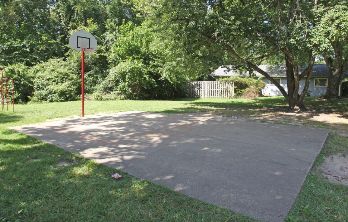 Basketball court with single hoop