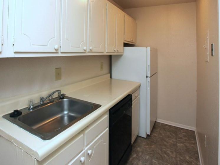 Kitchen with sink, dishwasher, refrigerator