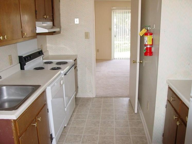 Kitchen with sink, dishwasher, range