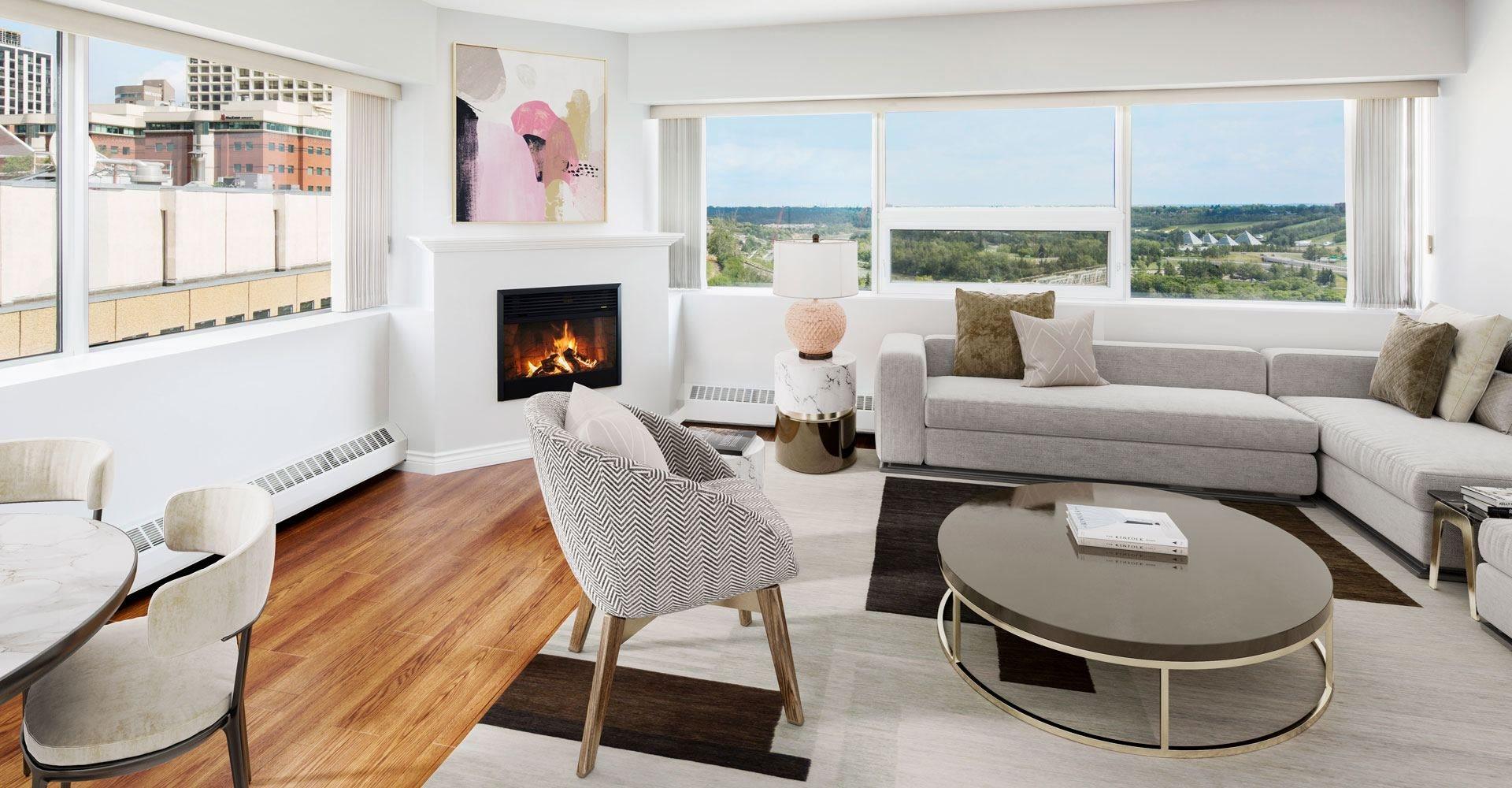 Livingroom with a sofa, table, area rug, and a fireplace