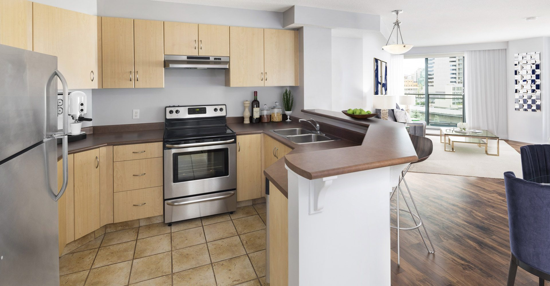 View of open concept kitchen with sink and stove
