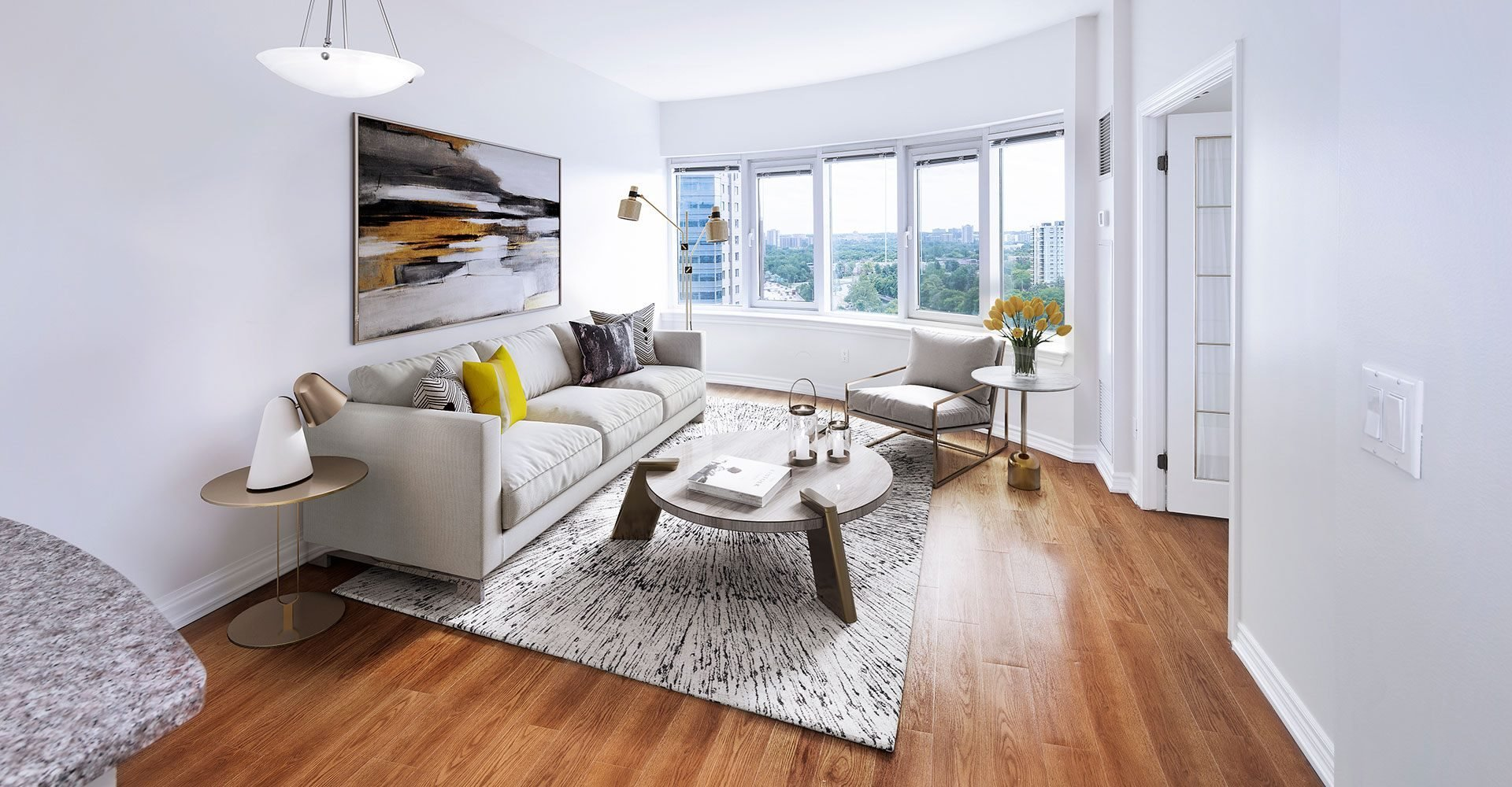 Staged unit with large windows allowing in lots of natural light