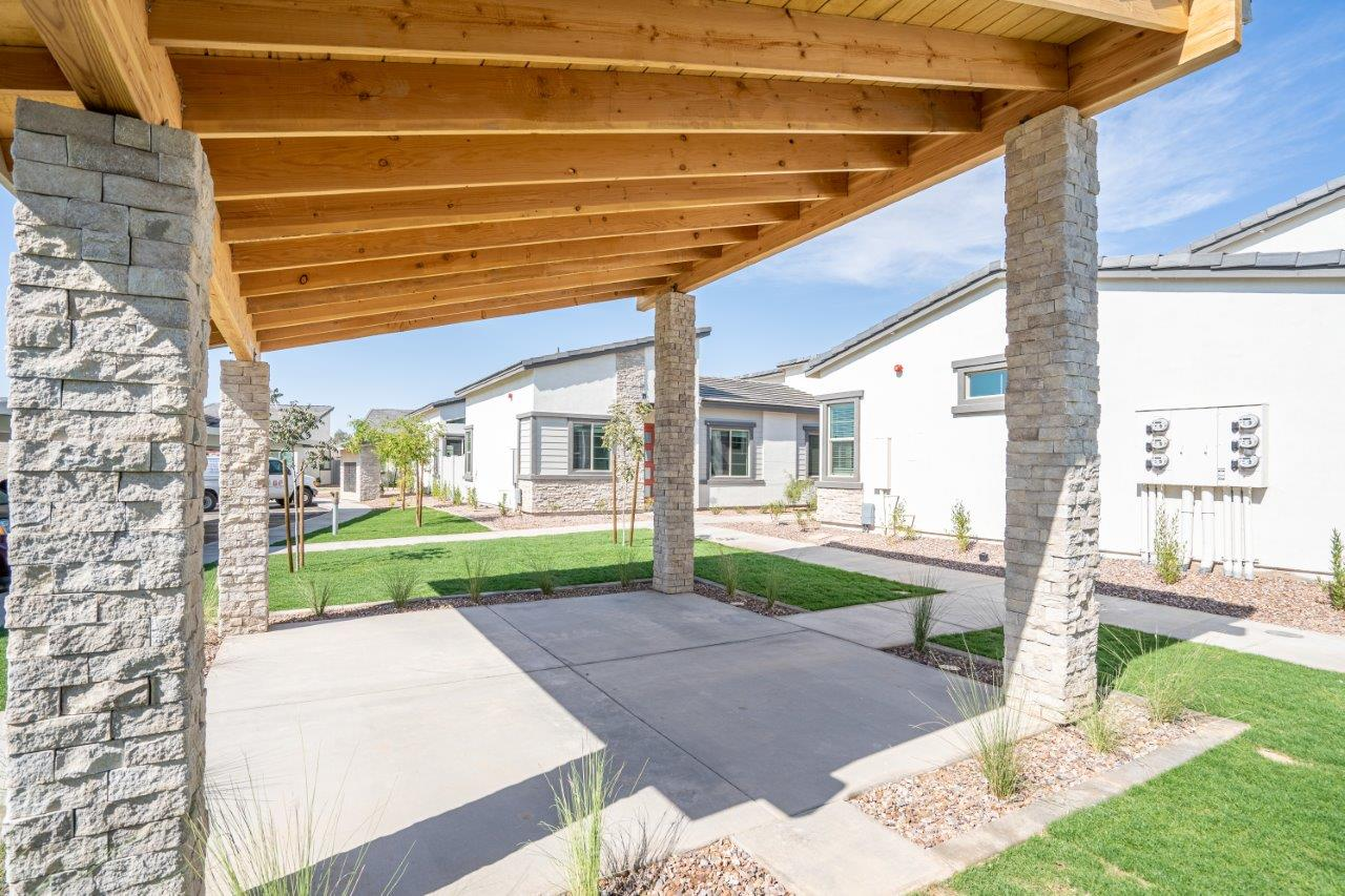 Shaded outdoor lounge area at Village Greens of Queen Creek