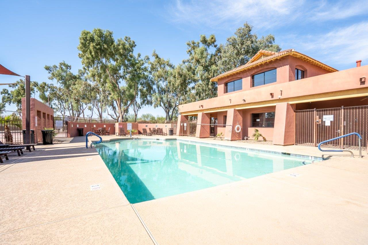 The pool is connected to the clubhouse at Village Greens of Queen Creek