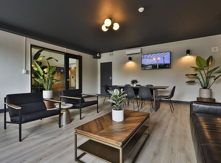 Living area with black sofas at Hill Park, Montreal, QC, H3V 1G1