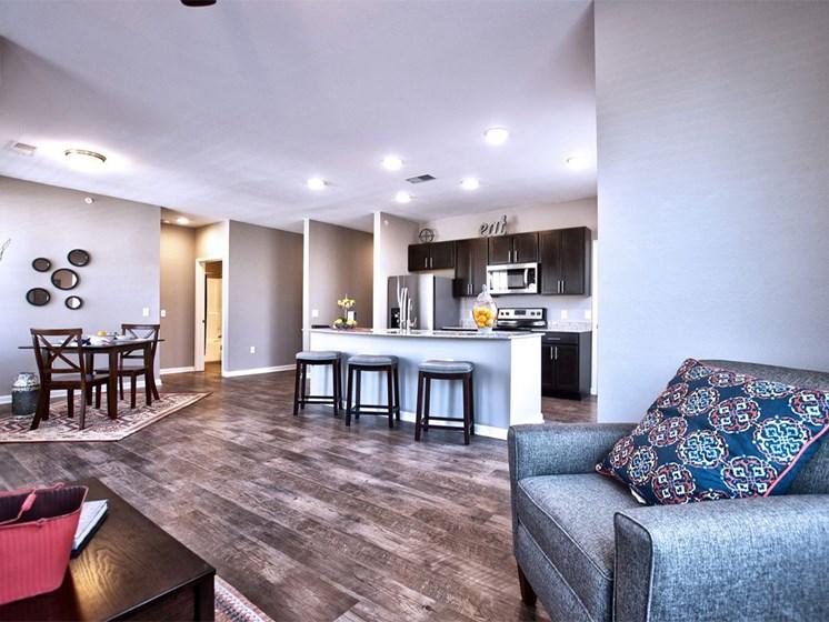 Apartments in Goshen, IN - Spacious Living Room With Modern Hardwood Floors and Open Floor Plan