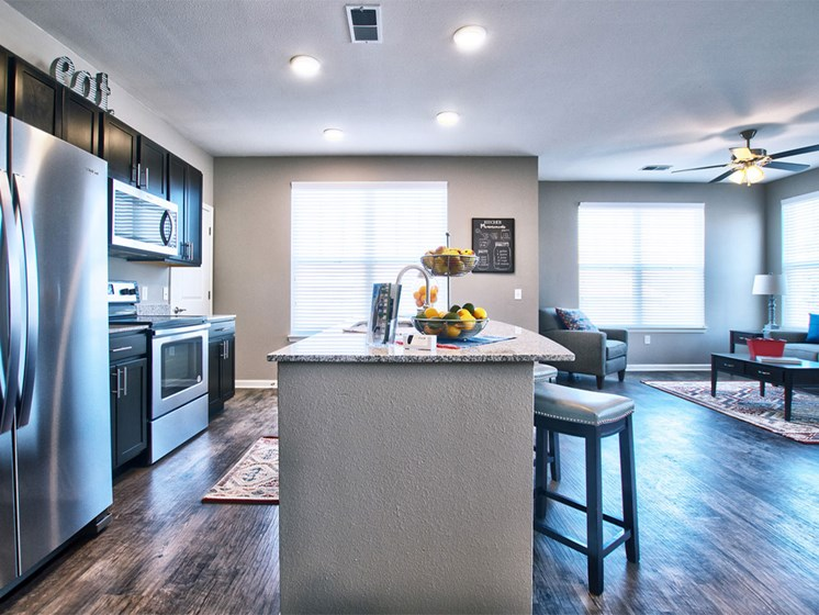 Apartments in Goshen - Apartment kitchen with island and stainless steel appliances