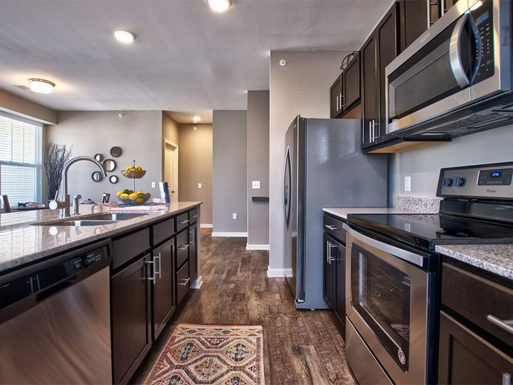 Apartments for Rent Goshen - Park Thirty-Three Apartments Kitchen with Wood-Style Flooring, Stainless Appliances, and Ample Counter Space