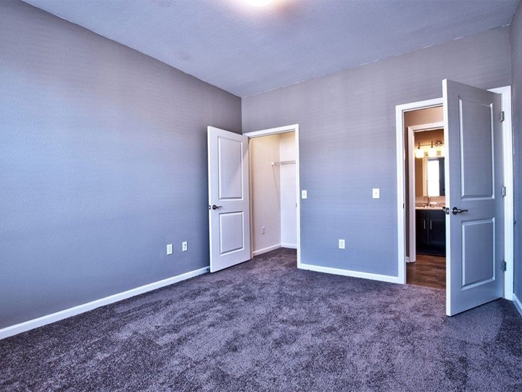 Apartments in Goshen - apartment bedroom with carpet flooring