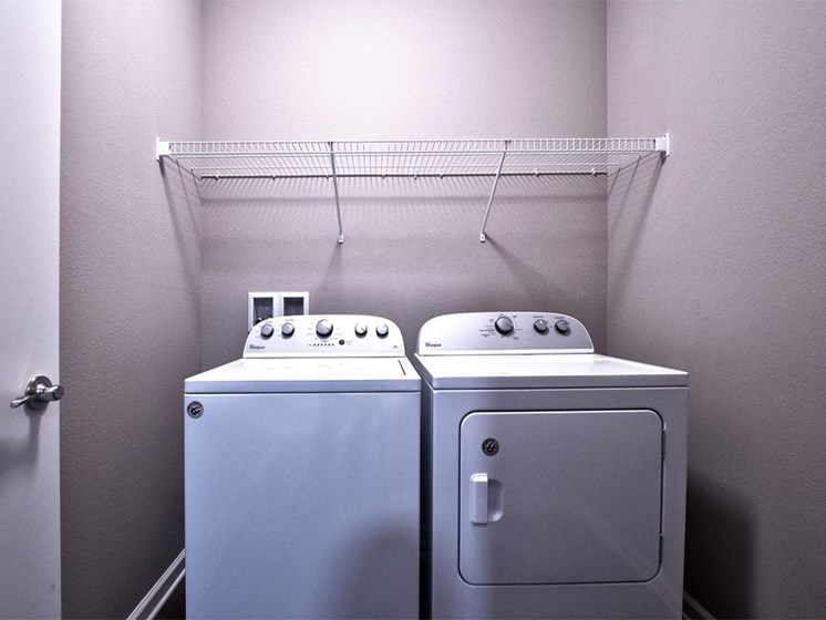 Apartments in Goshen - apartment laundry room with side-by-side washer and dryer