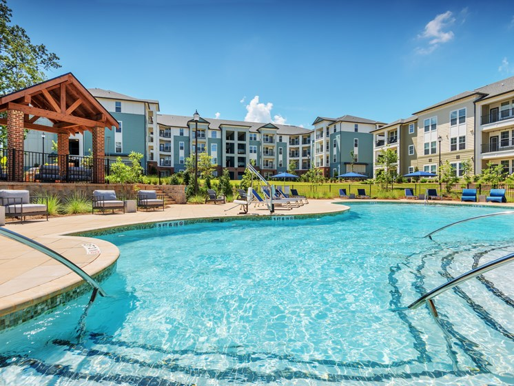 Apartments in Greenville - Trailside Verdae Salt Water Pool with Covered Porch, Soft Seating, and Shading Area
