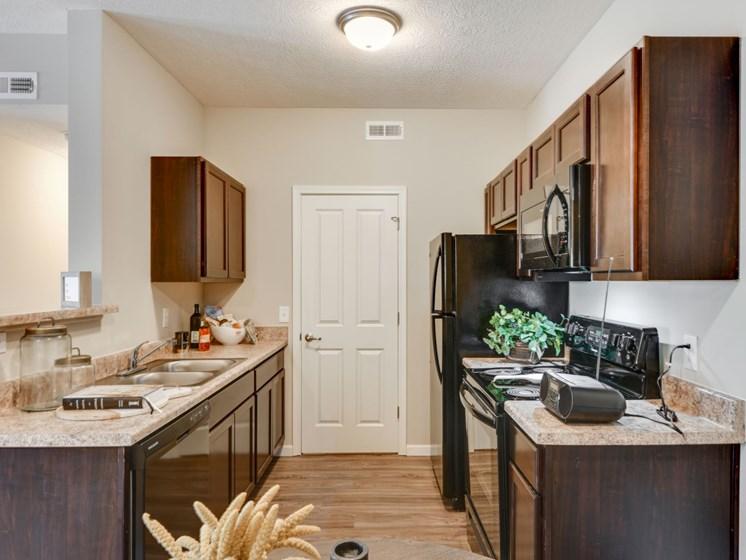 Black Appliances in Kitchen at Austin Place Apartments