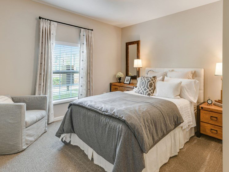 Bedroom with Bed and Chair at Austin Place Apartments