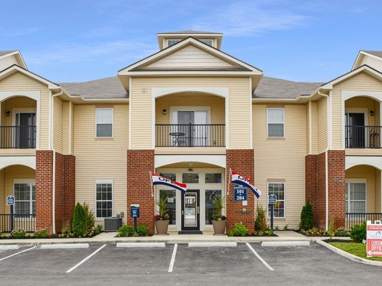 Exterior View Of Austin Place Apartments' Clubhouse Entrance