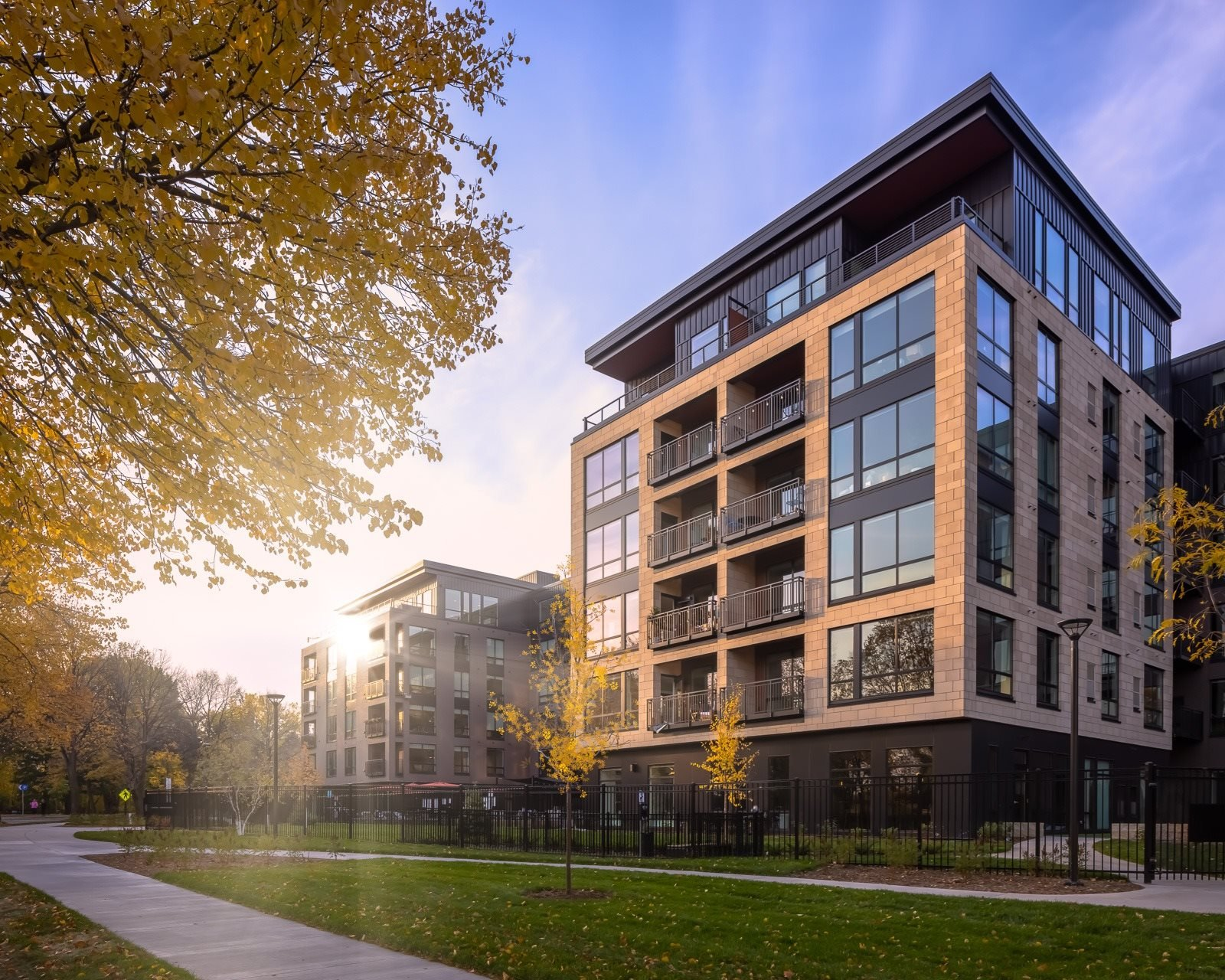 Vesi at West River Parkway with green space along river road