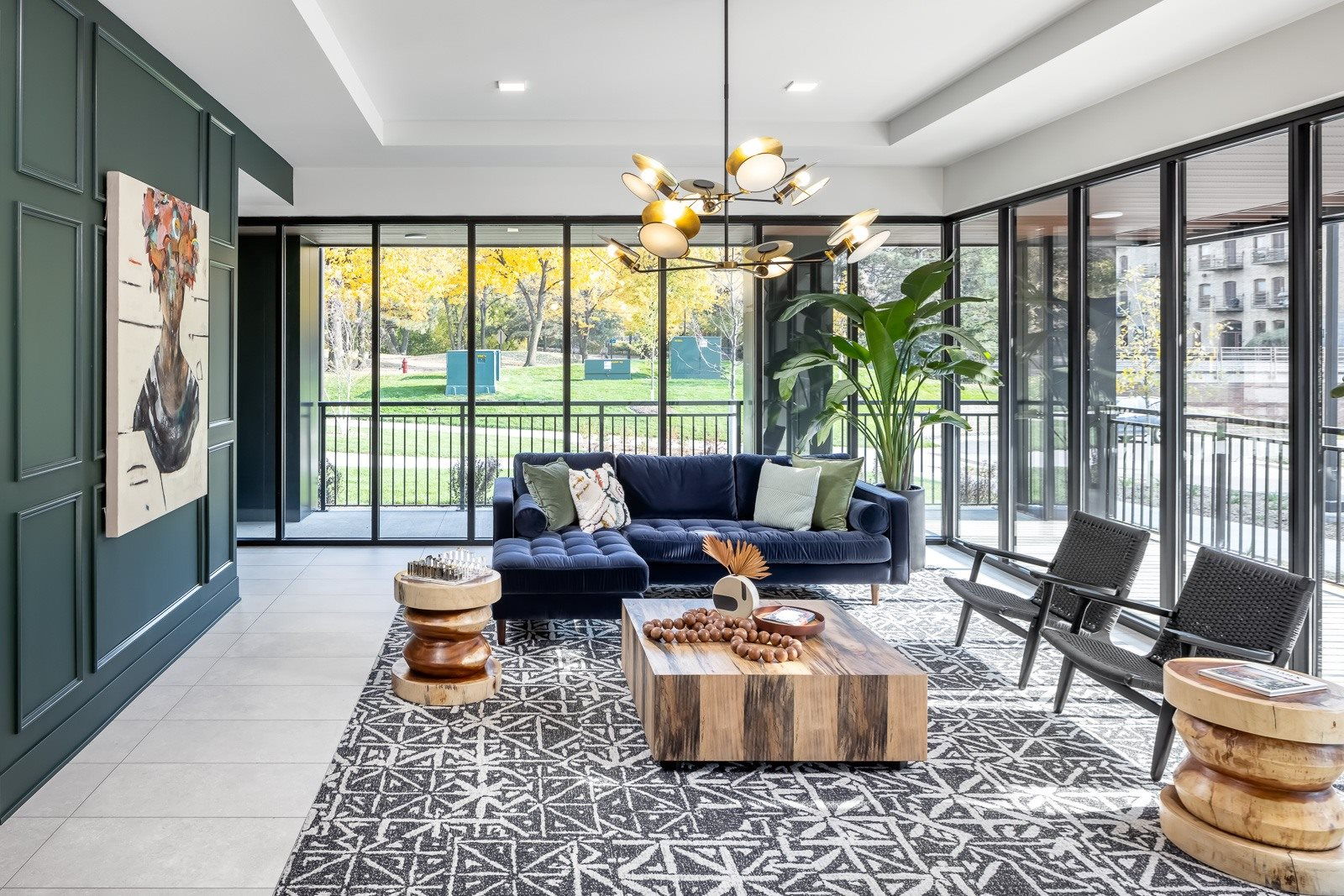 Lobby seating with floor to ceiling windows overlooking green landscaping in Minneapolis