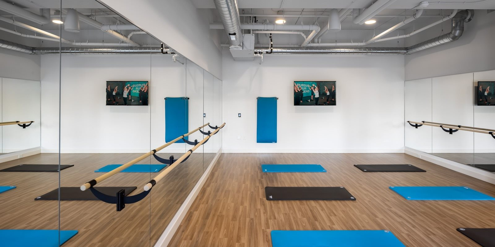 Yoga studio with Alchemy365 programming, barre and mirrors