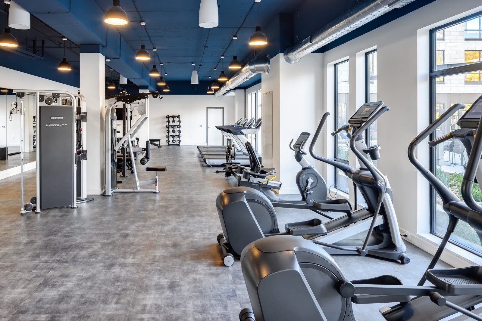 Fitness center with cardio and strength equipment for apartment residents