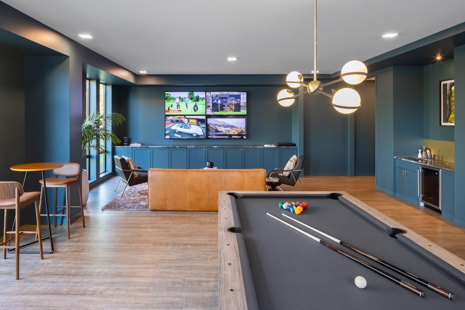 Den with pool table, wet bar, and entertainment seating