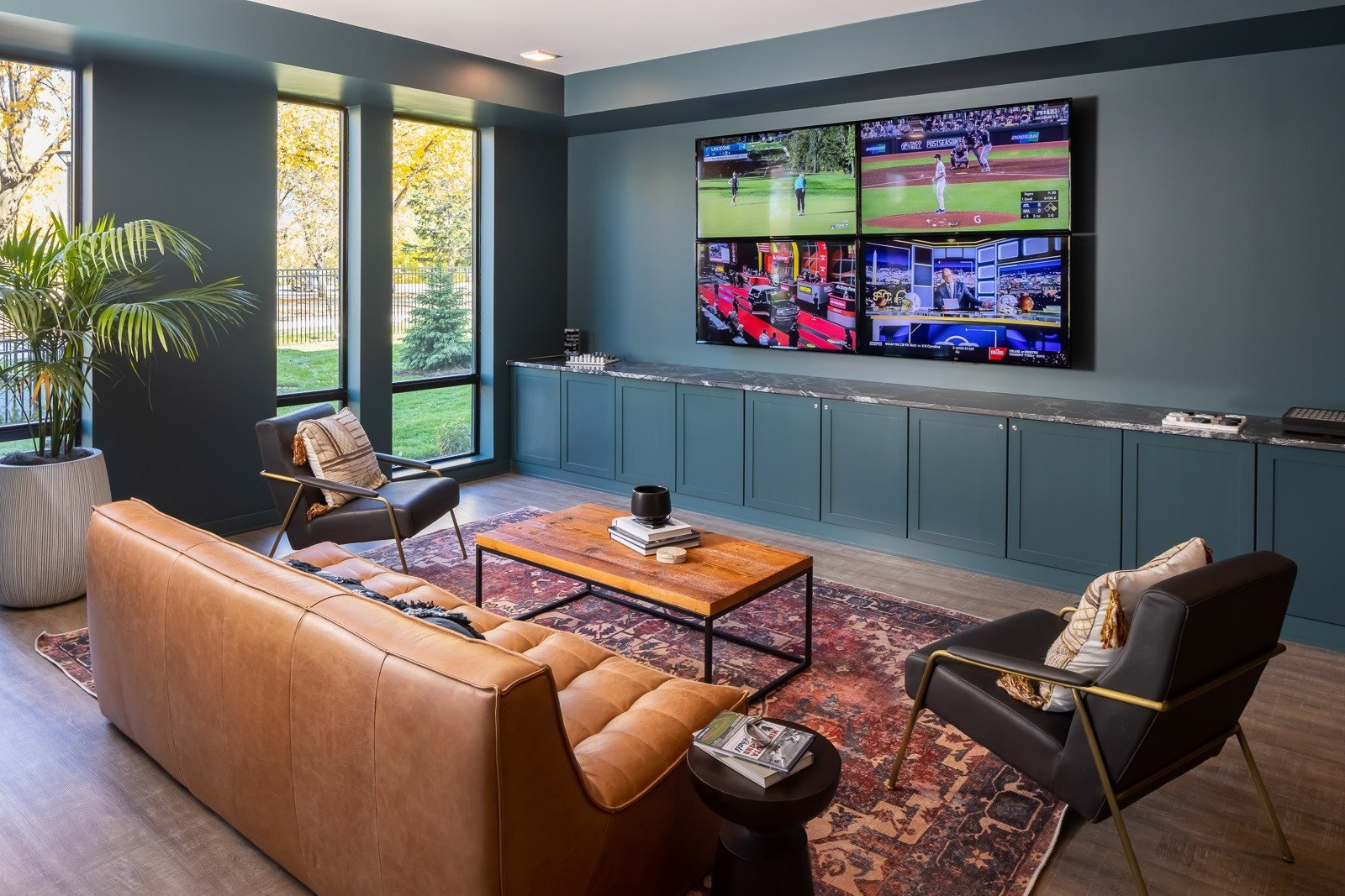 Den seating with four TV set-up