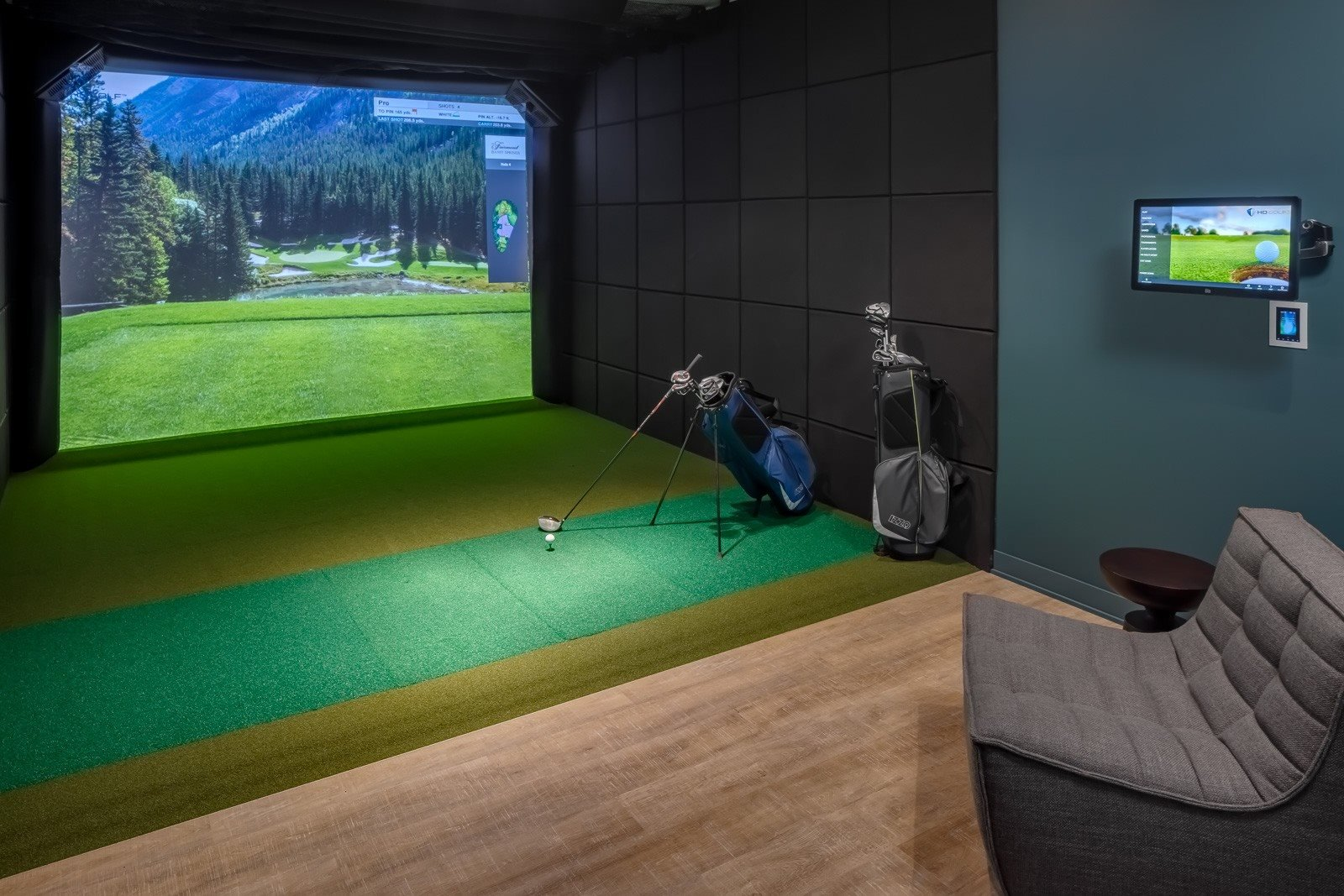 Golf simulator with clubs and pub style seating