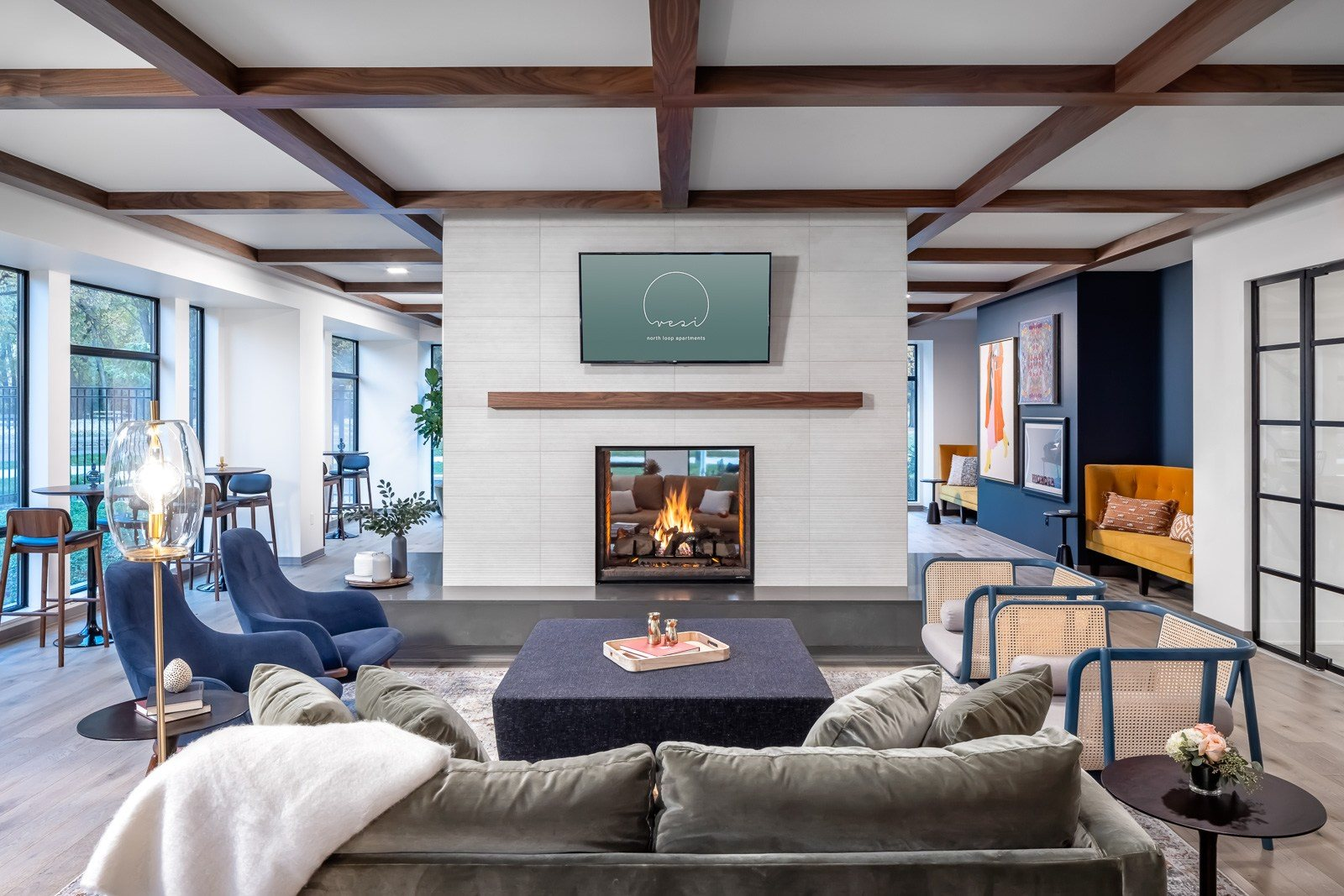 Seating in front of dual sided fireplace and TV in clubroom