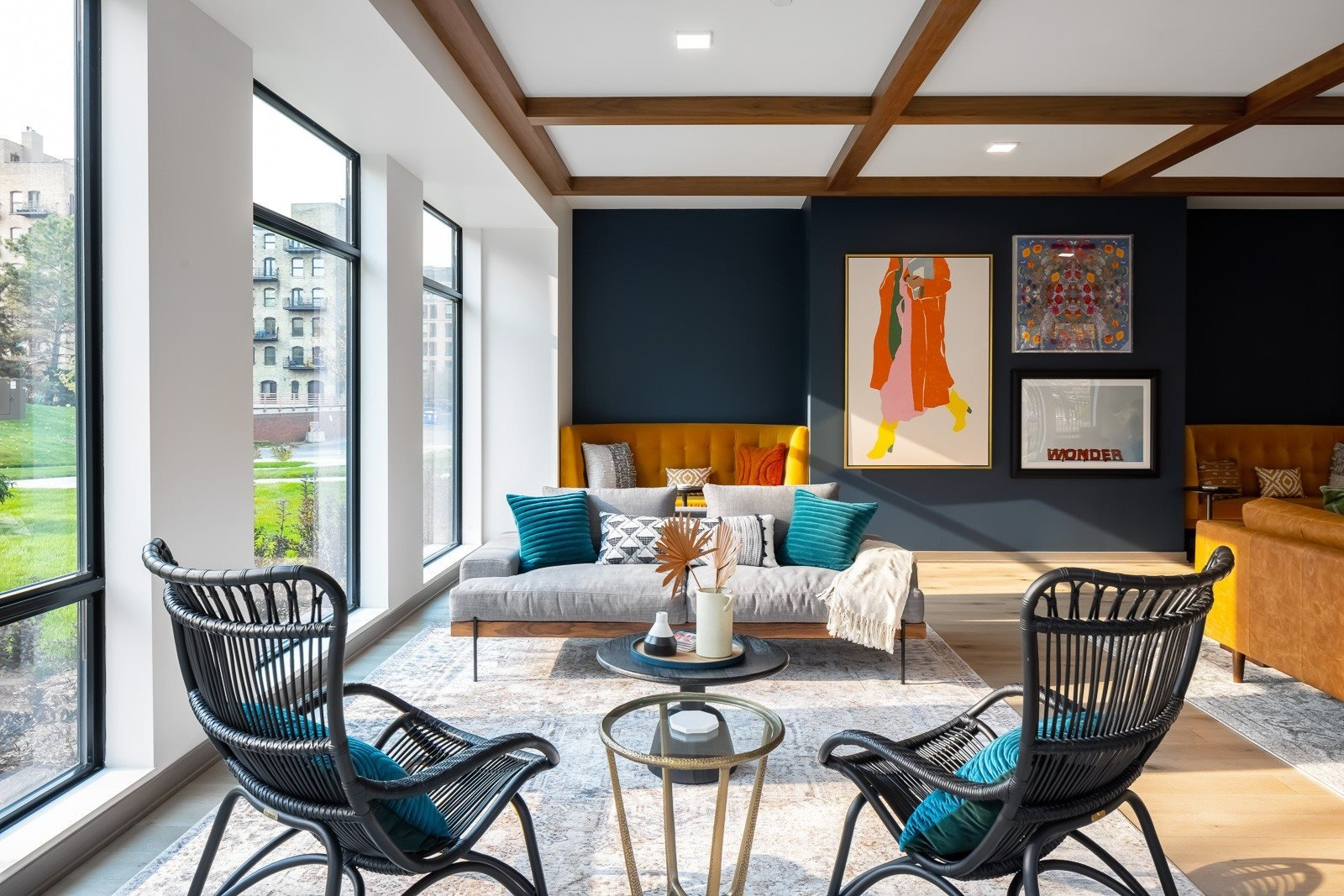 Seating in clubroom with curated art and natural light